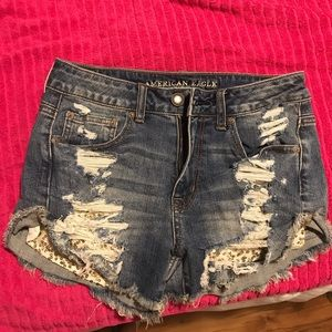 Distressed jean shorts with gold sparkle pockets